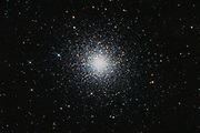 The Great Globular Cluster (Messier 13) in constellation Hercules. Also visible is the spiral galaxy NGC 6207, 30 million light years away from us.
