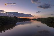 Sunset clouds reflect into Clam Bayou on Sanibel Island, Florida, USA