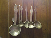 Indian made metal spoons used for cooking and make tea hang in a Brokpa kitchen in the remote village of Sakteng, Eastern Bhutan.