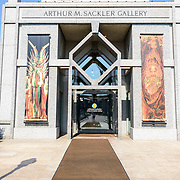 Sackler Gallery Entrance. The entrance to the Arthur M. Sackler Gallery. Located behind the Smithsonian Castle and nearly entirely underground, the Sackler Gallery showcases ancient and contemporary Asian art. The gallery was founded in 1982 after a major gift of artifacts and funding by Arthur M. Sackler. It is run by the Smithsonian Institution.