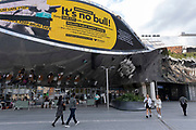 As numbers of Covid-19 cases in Birmingham have increased in recent weeks, and with the city added as an area of enhanced support on the UKs coronavirus watchlist of critical areas which are under threat of a local lockdown, people interact beneath a new public health advice advertising campaign featuring Bully the Bull Ring bull wearing a face mask with the slogan Its NO bull. Keep Brum safe outside Grand Central station in the city centre on 24th August 2020 in London, United Kingdom. With other areas in the Midlands under localised lockdown, people and businesses are being urged to follow the Coronavirus advice for workplace and family life help reduce the risk.