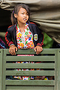 16 JUNE 2014 - POIPET, CAMBODIA:  A Cambodian migrant girl traveling with her parents waits in a Cambodian army truck to go back to her home village. More than 150,000 Cambodian migrant workers and their families have left Thailand since June 12. The exodus started when rumors circulated in the Cambodian migrant community that the Thai junta was going to crack down on undocumented workers. About 40,000 Cambodians were expected to return to Cambodia today. The mass exodus has stressed resources on both sides of the Thai/Cambodian border. The Cambodian town of Poipet has been over run with returning migrants. On the Thai side, in Aranyaprathet, the bus and train station has been flooded with Cambodians taking all of their possessions back to Cambodia.   PHOTO BY JACK KURTZ