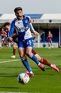 Bristol Rovers defender Cian Harris (25) is tackled from behind during the EFL Sky Bet League 1 match between Bristol Rovers and Ipswich Town at the Memorial Stadium, Bristol, England on 19 September 2020.