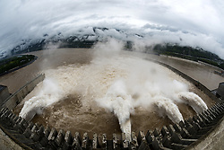 July 5, 2018 - Yichang, China - Water discharging from the Three Gorges Dam, a gigantic hydropower project on the Yangtze River, in central China's Hubei Province. At 8 a.m. on July 5, the reservoir faced an inflow of 51,000 cubic meters per second and an outflow of 40,000 cubic meters per second. The first flood of the Yangtze River this year has formed on its upper reaches.  (Credit Image: © Zheng Jiayu/Xinhua via ZUMA Wire)