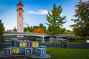 The Spokane clock tower was once part of a Great Northern Railway depot that once occupied the site.  Spokane is a city located in the Northwestern United States in the state of Washington. It is the largest city of Spokane County, of which it is also the county seat, and the metropolitan center of the Inland Northwest region. The city is located on the Spokane River in Eastern Washington, 92 miles (148 km) south of the Canadian border, approximately 15 miles (24 km) from the Washington–Idaho border, and 230 miles (370 km) east of Seattle.