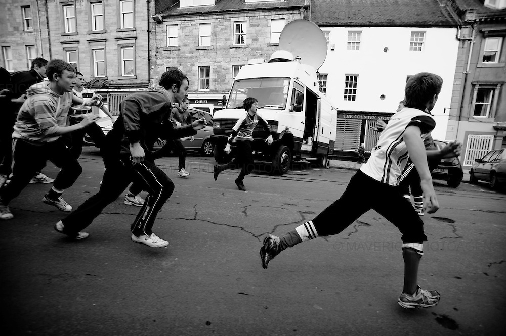 """THE townsfolk of Jedburgh squared up to each other today for the annual Jethard HandBa'.  The traditional ball game, which has been played in the Border town for 250 years, pits the Uppies (residents of the higher part of Jedburgh) against the Doonies (residents from the bottom half of the town).  The game uses a leather ball stuffed with straw and decorated with ribbons. It is then thrown into the group of men which gather together in a scrum and then manhandle it through the streets.  The aim of the game is to """"hail"""" the ball to the respective side of the town. For the Uppies it is the castle and for the Doonies it is the Jedwater."""