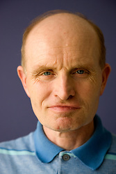 Portrait of day service user with learning disability looking thoughtful,