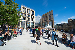 Edinburgh, Scotland, UK. 24 June 2021. First images of the new St James Quarter which opened this morning in Edinburgh. The large retail and residential complex replaced the St James Centre which occupied the site for many years. Pic; Members of the  public milling about entrance to mall at Leith Street .Iain Masterton/Alamy Live News