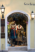 Window display of dirndl dresses in Kaiser am Platzll gift shop in Pfisterstrasse in Munich, Bavaria, Germany