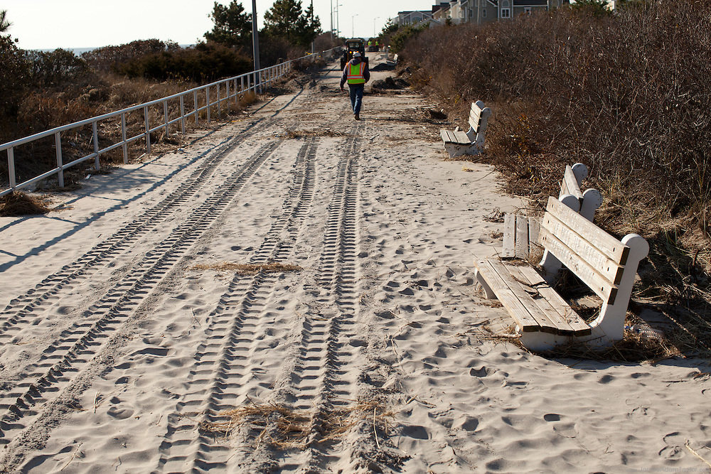 Work is underway to free of Sea Isle Cities Boardwalk from the foot or more of sand left by Super Storm Sandy.