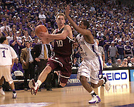 Texas A&M guard Chris Walker (10) drives to the basket against pressure from Kansas State guard Clent Stewart (5) during the first half of K-State's 58-54 win over the Aggies at Bramlage Coliseum in Manhattan, Kansas, January 18, 2006.