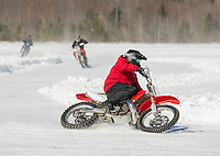 Perfect ice conditions for Chris Hall, Tyler Sweeney and Travis Bickford racing around the plowed track on Lily Pond Saturday morning.  (Karen Bobotas/for the Laconia Daily Sun)