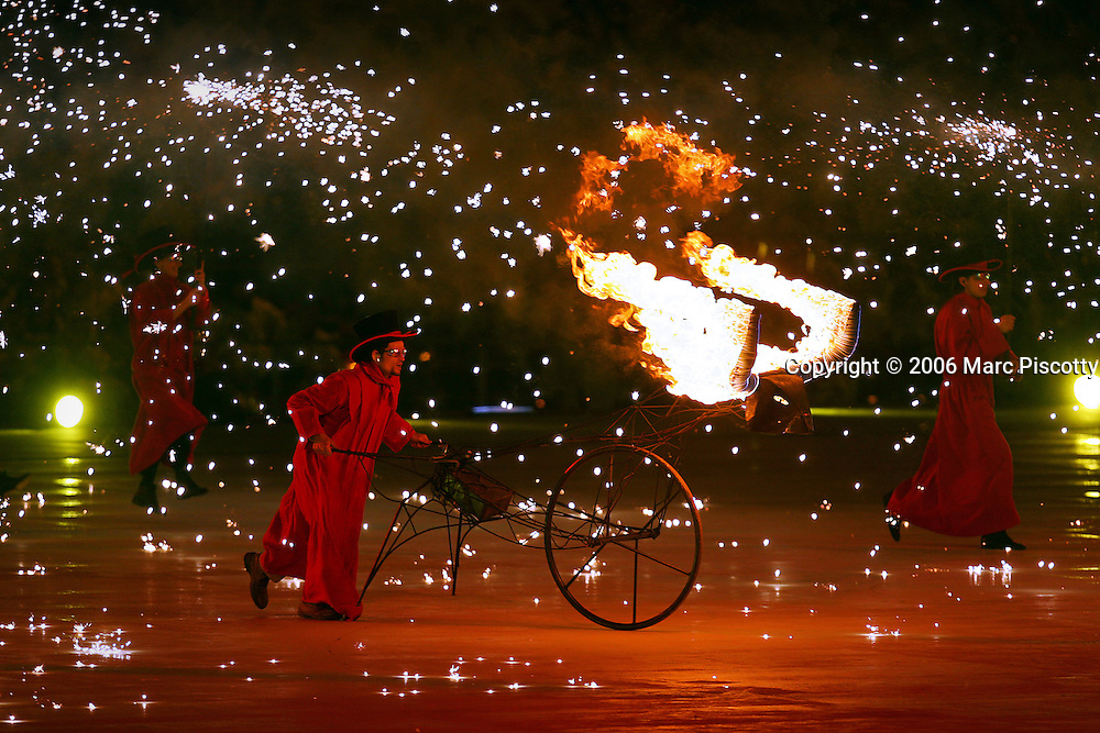 A flaming bull is pushed around stage by a performer duirng the Closing Ceremony for the 2006 Winter Olympics on Sunday February 26, 2005 at the Stadio Olimpico in Turin, Italy. The Closing Ceremony featured a dizzying array of circus acts, parades and a general carnival atmosphere. Performers included clowns swivelling in large hoops, ballerinas and tumblers, acrobats dangling high above the stage from ribbons and rings, a stilt walker jumping rope, dancers dressed as Tarot cards and highflying acrobats performing over a tunnel of wind. The Closing Ceremony capped off 16 days of Olympic competition that saw the U.S. win 25 total medals, second to only Germany with 29 total medals..(Photo by Marc Piscotty/ © 2006)