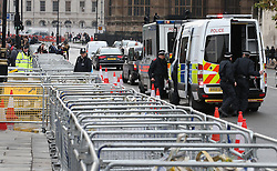 © Licensed to London News Pictures. 04/11/2015. London, UK. Police install barriers outside Parliament ahead of a student protest in central London over fees and cuts. Photo credit: Peter Macdiarmid/LNP