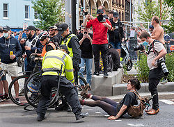 © Licensed to London News Pictures; 13/06/2020; Bristol, UK. A woman on a bicycle appears to remonstrate with protestors at an 'All Lives Matter' protest rally at the Cenotaph war memorial in Bristol city centre. Police pulled her away from protestors and bikers who were leaving the plaza. Earlier at the event there were scuffles and a black man appeared to get punched in the face. The event comes nearly a week after the Black Lives Matter march when the statue of Bristol slave trader and philanthropist Edward Colston was pulled down from a plinth nearby and thrown into Bristol harbour. Despite the restrictions due to the Covid-19 coronavirus pandemic, Black Lives Matter protests have occurred across the world in memory of George Floyd, a black man who was killed on May 25, 2020 in Minneapolis in the US by a white police officer kneeling on his neck for nearly 9 minutes. Photo credit: Simon Chapman/LNP.