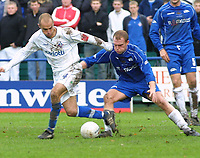 Photo: Dave Linney.<br />Chasetown v Oldham Athletic. The FA Cup. 06/11/2005.<br />Paul Edwards(Oldham) holds off the challenge from Damian Whitcombe.