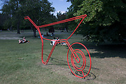 Frieze Sculpture 2017 opens to the public on July 5th 2017 in the English Gardens in Regents Park, London, England, United Kingdom. This is London's largest showcase of major outdoor works by leading artists and galleries, presenting a free outdoor exhibition for London and its international visitors throughout the summer months. Michael Craig-Martin, Wheelbarrow red 2013.