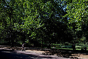 Cycling alongside St James' Park in central London. One of the Royal parks, located running between The Mall and Birdcage Walk.
