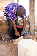Hamidu Saidi making a foot stool. He is one of the owners of Mnyangu Sofa Seat a local sofa making company, part of the VSO / ICS Elimu Fursa project (Opportunities in Education) Lindi, Lindi region. Tanzania.