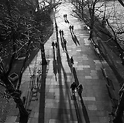 Aerial view of pedestrian couples walking together on London's South Bank embankment.