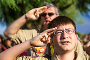 26 MAY 2012 - PHOENIX, AZ:  JAMES MARLAR, from Boy Scout Troop 818 in Phoenix, salutes during the National Anthem at the National Memorial Cemetery in Phoenix, AZ, Saturday. Marlar and his troop came to the cemetery to place flags on veterans' graves. Hundreds of Boy and Girl Scouts along with the Young Marines, a Scout like organization, who place American flags on veterans' graves in the National Memorial Cemetery in Phoenix every year on the Saturday before Memorial Day.       PHOTO BY JACK KURTZ