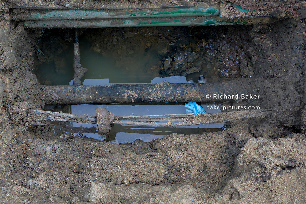 Detail of a pit excavated for the upgrading of gas supplies works by contractors JDT on behalf of SGN, on 13th February 2019, in London, England.