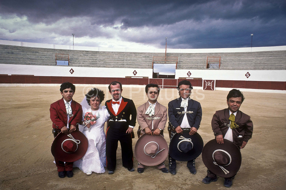 """Bride groom Guillermo Gomez and his just married wife Joaquina, together with their troupe of fellow dwarfs inside Cienpozuelo's bull ring after their wedding ceremony. Their troupe travel around Spain fighting bulls, Guillermo is the """"matador"""" bullfighter, the rest are the """"picadores"""" the lancers."""