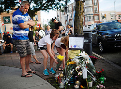 People add flowers and messages to a memorial remembering the victims of a shooting on Sunday evening on Danforth, Ave. in Toronto, ON, Canada, on Monday, July 23, 2018. Photo by Mark Blinch/CP/ABACAPRESS.COM