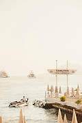 Carlton Inter Continental pier and motorboat and cruisers on sea, Cannes, France