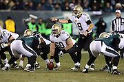 New Orleans Saints quarterback Drew Brees (9) points as New Orleans Saints center Brian de la Puente (60) gets set to snap the ball during the NFL NFC Wild Card football game against the Philadelphia Eagles on Saturday, Jan. 4, 2014 in Philadelphia. The Saints won the game 26-24. ©Paul Anthony Spinelli