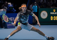 Tennis - 2019 Nitto ATP Finals at The O2 - Day Two<br /> <br /> Singles Group Andre Agassi: Daniil Medvedev vs. Stefanos Tsitsipas<br /> <br /> Stefanos Tsitsipas (Greece) performs the splits whilst getting a with a forehand return back <br /> <br /> COLORSPORT/DANIEL BEARHAM<br /> <br /> COLORSPORT/DANIEL BEARHAM
