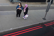 A young Muslim woman holds a Union Jack shopping bag on Westminster Bridge, in Lambeth, on 28th March 2019, in London, England.