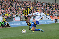Burton No.10 Lucas Akins rides a tackler in the Sky Bet League 1 match between Burton Albion and Bury at the Pirelli Stadium, Burton upon Trent, England on 2 April 2016. Photo by Nigel Cole.