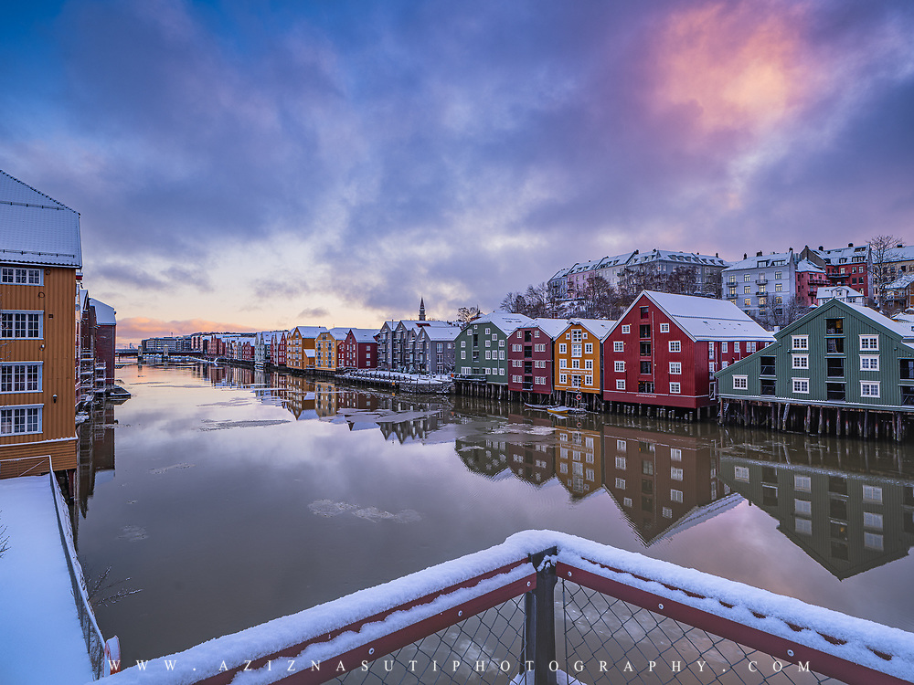 www.aziznasutiphotography.com                                          Picture has been taken in between in a calm and beautiful March sunrise over the famous Trondheim's wooden houses in Norway. From Gamle bybro or old town bridge.