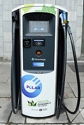 © Licensed to London News Pictures. 08/04/2019. LONDON, UK.  A fast roadside charging point for electric cars in Southwark. Electric cars are exempt from the Ultra Low Emission Zone which is in force 24 hours a day.  Coming into effect on 8 April, within the same area of central London as the Congestion Charge, most vehicles, including cars and vans, need to meet the ULEZ emissions standards or their drivers must pay a daily charge to drive within the zone.  The ULEZ is an initiative to improve air quality and public health in central London and is supported by the Mayor of London.  Photo credit: Stephen Chung/LNP