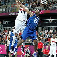 29 July 2012: USA Anthony Davis is fouled by Boris Diaw of France during the 98-71 Team USA victory over Team France, during the men's basketball preliminary, at the Basketball Arena, in London, Great Britain.