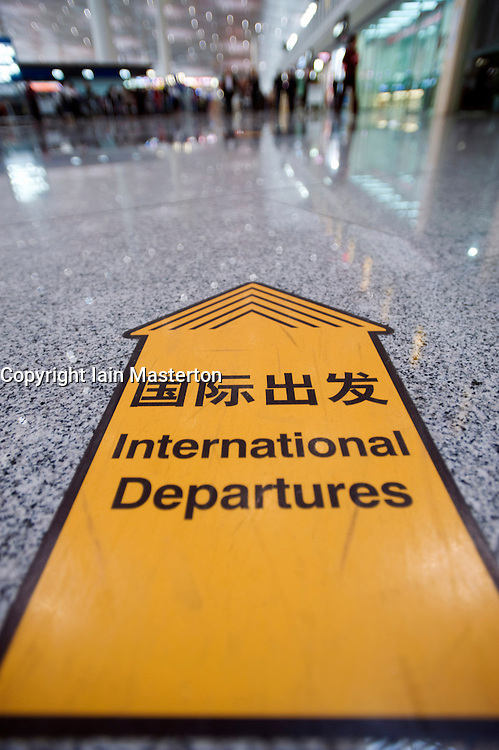Floor sign to International departures  of new Terminal 3 at Beijing International Airport 2009