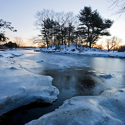 A frozen tidal pond in Portsmouth, New Hampshire.  Society for the Protection of New Hampshire Forests' Creek Farm Reservation.  Dawn.