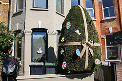 © Licensed to London News Pictures. 05/04/2020. London, UK. A hedge in the front garden of a house in Haringey, north London is decorated as an Easter Egg. Photo credit: Dinendra Haria/LNP