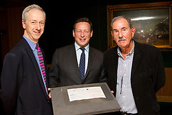 "© Licensed to London News Pictures. 22/05/2013. London, UK. Roly Keating, the chief executive of the British Library (L), Ed Vaizey, the British Minister for Culture (C) and Hunter Davies, an acclaimed Beatles Biographer, are seen with the lyrics for the Beatles song 'Strawberry Fields' at the British Library in London today (22/05/2013).  The manuscript, along with others and letters between John Lennon and Mr Davies, have been donated to the library under the ""lifetime giving"" scheme. Photo credit: Matt Cetti-Roberts/LNP"