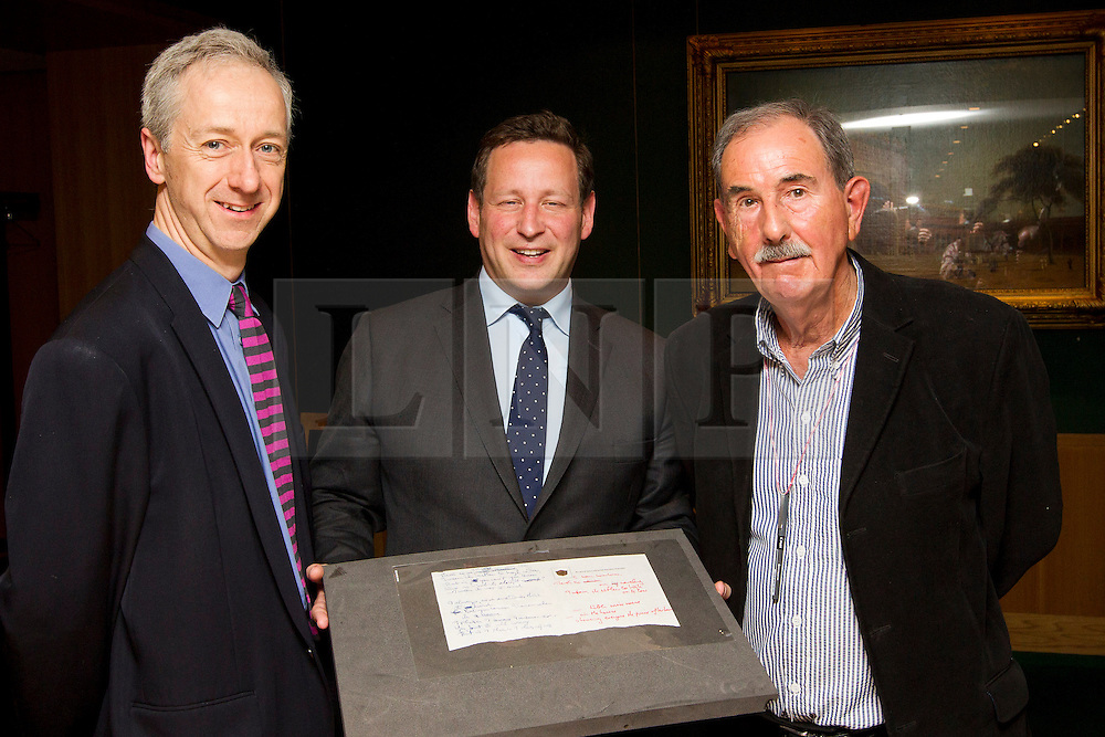 """© Licensed to London News Pictures. 22/05/2013. London, UK. Roly Keating, the chief executive of the British Library (L), Ed Vaizey, the British Minister for Culture (C) and Hunter Davies, an acclaimed Beatles Biographer, are seen with the lyrics for the Beatles song 'Strawberry Fields' at the British Library in London today (22/05/2013).  The manuscript, along with others and letters between John Lennon and Mr Davies, have been donated to the library under the """"lifetime giving"""" scheme. Photo credit: Matt Cetti-Roberts/LNP"""