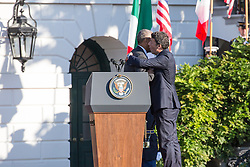October 18, 2016 - Washington, DC, United States - On the South Lawn  of the White House in Washington, D.C., U.S., on Tuesday, Oct. 18, 2016., (l-r), President Barack Obama hugs Italian Prime Minister Matteo Renzi, after speaking at the Official State Visit. This was the last Official State Visit for the Obama administration. (Credit Image: © Cheriss May/NurPhoto via ZUMA Press)