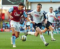 Photo: Ed Godden.<br />Aston Villa v Portsmouth. The Barclays Premiership. 04/03/2006. <br />Milan Baros (L) enters the Portsmouth area.