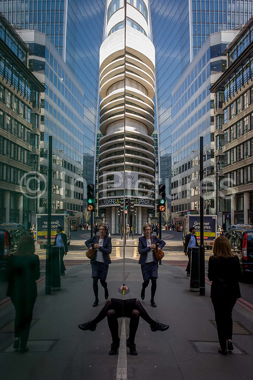 A symmetrical scene of London city workers out walking and shopping at lunchtime, with tall office buildings rising above. Seen parallel to a large retailer's front window, the world beyond is seen as a mirror image, duplicating left and right halves, to show the capital's financial and oldest district, as a double picture. A woman's legs are seen as disjointed limbs, a funny comment on urban lives.