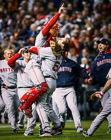 Denver, CO -- Boston Red Sox pitcher Jonathan Papelbon (58) and Boston Red Sox catcher Jason Varitek (33) celebrate winning the 2007 World Series 4-3 over the Colorado Rockies. -- Photo by Jack Gruber, USA TODAY
