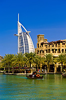 Madinat Jumeirah hotel in foreground and Burj al Arab Hotel in background, Dubai, United Arab Emirates