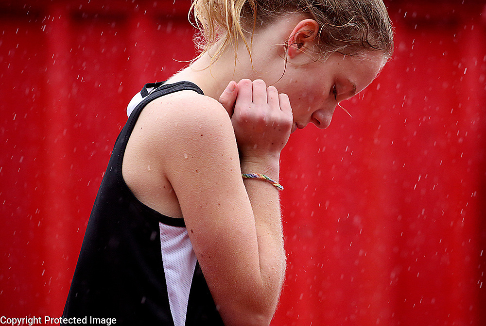 San Lorenzo Valley High School 400  meter runner Summer Hipwell composes herself during a downpour as she waits for the gun to fire during a home meet against Santa Cruz in Felton, California on March 15, 2018.<br /> Photo by Shmuel Thaler <br /> shmuel_thaler@yahoo.com www.shmuelthaler.com
