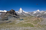 Matterhorn and Rifflesee with helicopter in the air, from Rotenboden station, nr Zermatt. Switzerland