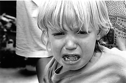 Closeup of young child crying,