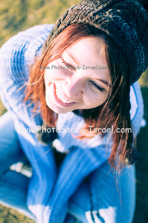 Young 25 year old woman enjoys herself alone in the park